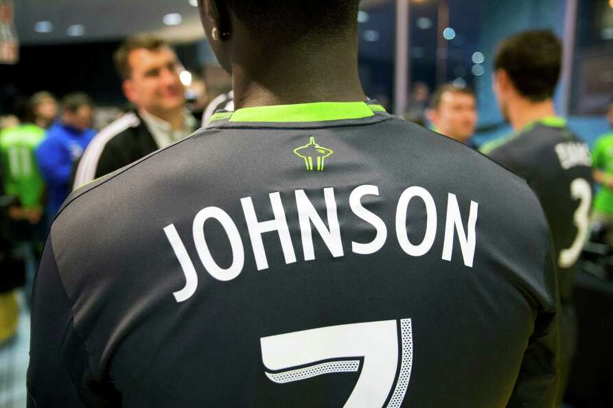 Eddie Johnson wears the new secondary uniforms of the Seattle Sounders FC on Wednesday, Feb. 27, 201