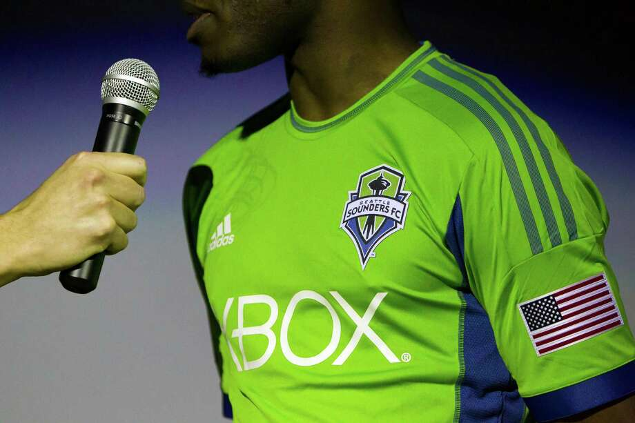 Steve Zakuani answers questions at the unveiling event for the new uniforms of the Seattle Sounders FC on Wednesday, Feb. 27, 2013, at the Cinerama in downtown Seattle, Wash. Both outfits - primary and secondary - boasted reduced fabric weights and a change in some stitching materials. Photo: JORDAN STEAD / SEATTLEPI.COM