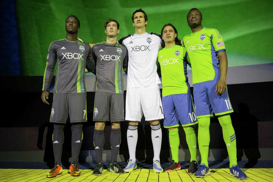 Sounders FC players show off their new threads at the unveiling event for the new uniforms of the Seattle Sounders FC on Wednesday, Feb. 27, 2013, at the Cinerama in downtown Seattle, Wash. Both outfits - primary and secondary - boasted reduced fabric weights and a change in some stitching materials. Photo: JORDAN STEAD / SEATTLEPI.COM