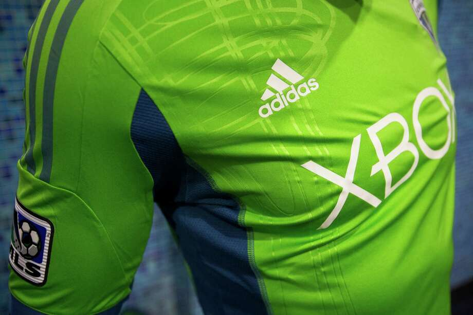 Details of the new primary uniforms of the Seattle Sounders FC display on Wednesday, Feb. 27, 2013, at the Cinerama in downtown Seattle, Wash. Both outfits - primary and secondary - boasted reduced fabric weights and a change in some stitching materials. Photo: JORDAN STEAD / SEATTLEPI.COM