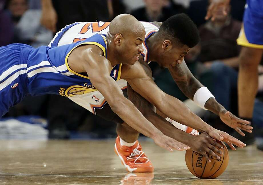 Golden State Warriors' Jarrett Jack, left, and New York Knicks' Iman Shumpert dive for a loose ball during the first half of an NBA basketball game on Wednesday, Feb. 27, 2013, in New York. (AP Photo/Frank Franklin II) Photo: Frank Franklin II, Associated Press