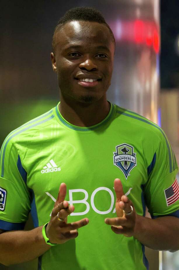 Steve Zakuani smiles for the cameras at the unveiling event for the new uniforms of the Seattle Sounders FC on Wednesday, Feb. 27, 2013, at the Cinerama in downtown Seattle, Wash. Both outfits - primary and secondary - boasted reduced fabric weights and a change in some stitching materials. Photo: JORDAN STEAD / SEATTLEPI.COM