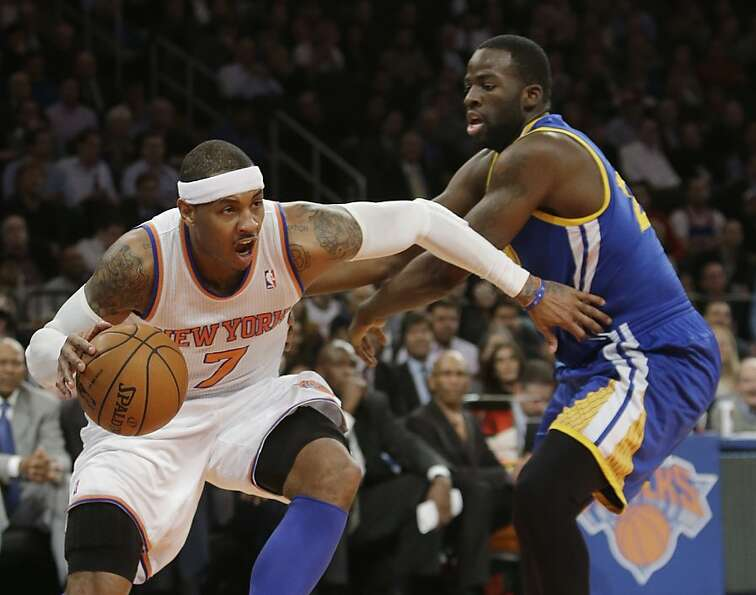 New York Knicks' Carmelo Anthony (7) drives past Golden State Warriors' Draymond Green during the