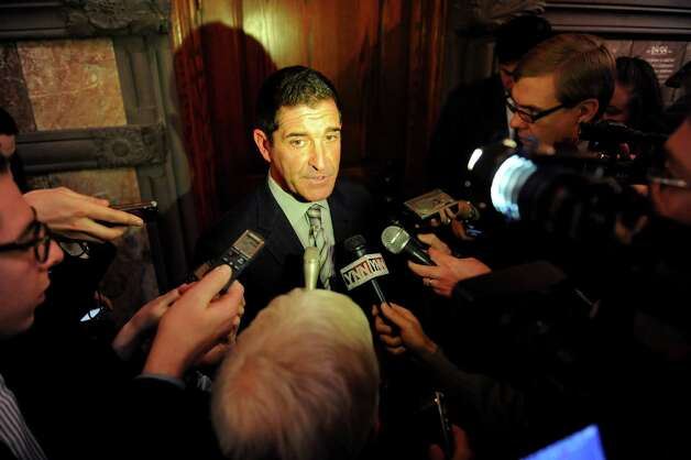 Sen. Jeff Klein, center, talks to the media about raising the minimum wage on Wednesday, Feb. 27, 2013, at the Capitol in Albany, N.Y. (Cindy Schultz / Times Union) Photo: Cindy Schultz / 00021331A