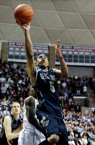 Georgetown's Markel Starks goes up for a basket during the first overtime of an NCAA college basketball game against Connecticut in Storrs, Conn., Wednesday, Feb. 27, 2013. Georgetown won 79-78. (AP Photo/Jessica Hill) Photo: Jessica Hill, Associated Press / FR125654 AP