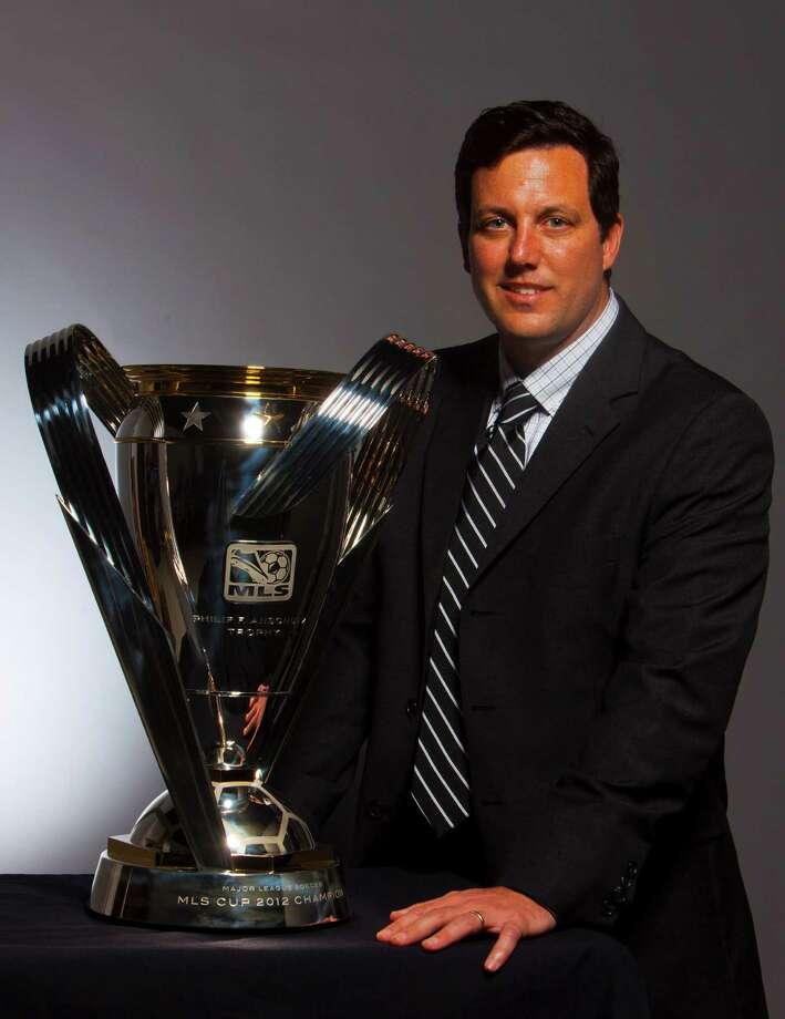 Dynamo team president Chris Canetti with the MLS Cup Trophy at the Houston Chronicle studio. Tuesday, Nov. 20, 2012, in Houston. ( Billy Smith II / Houston Chronicle ) Photo: Billy Smith II, Staff / © 2012 Houston Chronicle