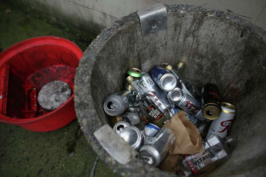 Booze and beer cans and bottles are shown in a trash can outside of the Lake City Grocery Outlet. The store is struggling because of a significant increase in theft. The 