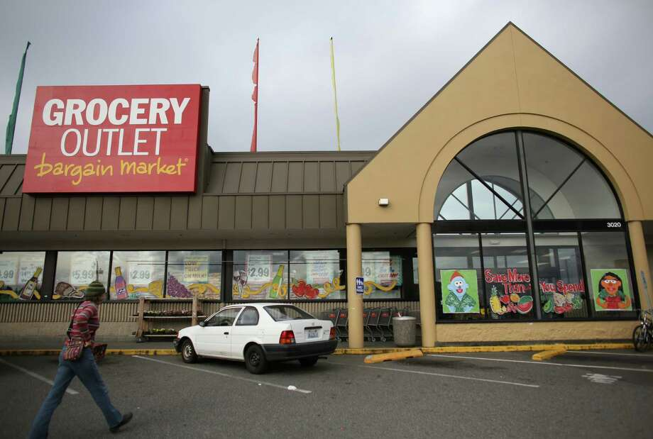 A customer walks toward the Lake City Grocery Outlet. The store is struggling because of a significant increase in theft. The 