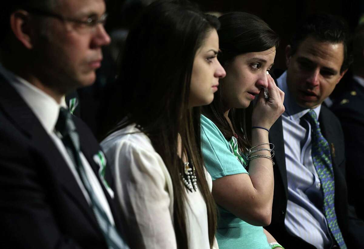 """WASHINGTON, DC - FEBRUARY 27: Sisters of Sandy Hook Elementary shooting victim first-grade teacher Victoria Soto, Jillian Soto (3rd L) wipes tears as she listens with Carlee Soto (2nd L) during a hearing before the Senate Judiciary Committee February 27, 2013 on Capitol Hill in Washington, DC. The committee held a hearing on """"The Assault Weapons Ban of 2013."""" (Photo by Alex Wong/Getty Images)"""