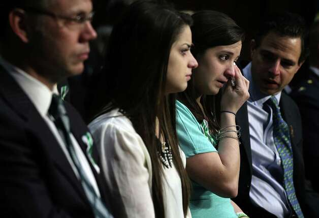 "WASHINGTON, DC - FEBRUARY 27:  Sisters of Sandy Hook Elementary shooting victim first-grade teacher Victoria Soto, Jillian Soto (3rd L) wipes tears as she listens with Carlee Soto (2nd L) during a hearing before the Senate Judiciary Committee February 27, 2013 on Capitol Hill in Washington, DC. The committee held a hearing on ""The Assault Weapons Ban of 2013.""  (Photo by Alex Wong/Getty Images) Photo: Alex Wong, Getty Images / 2013 Getty Images"