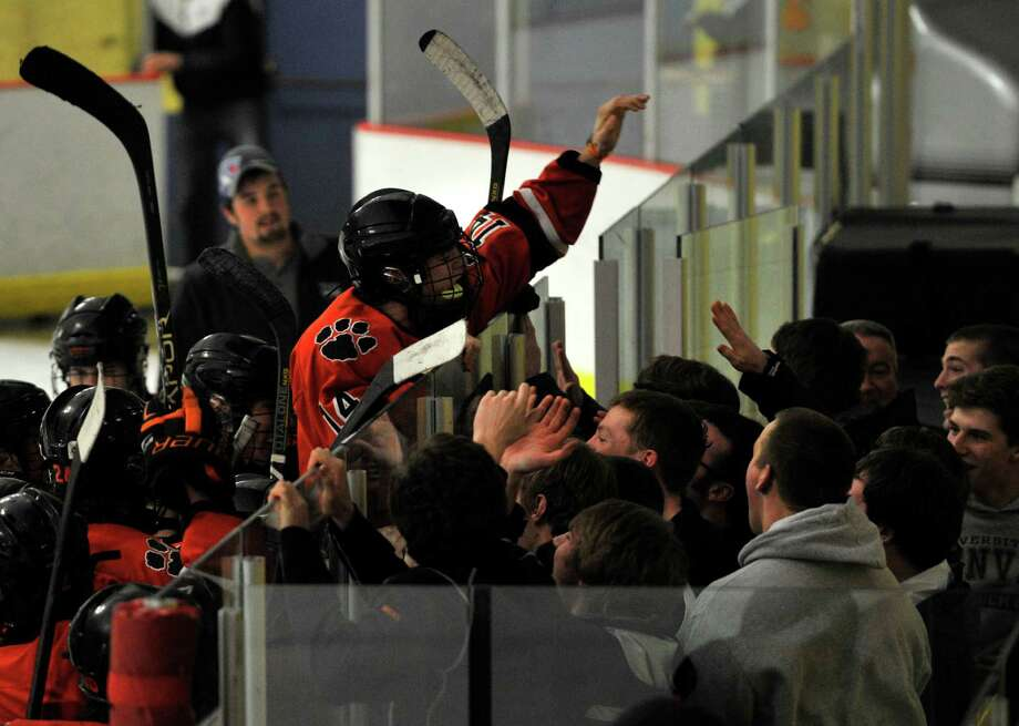 Ridgefield players celebrate with fans after the Tiger's FCIAC semifinal win over Darien at Terry Conners Rink in Stamford on Wednesday, Feb. 27, 2013. Photo: Jason Rearick / The Advocate