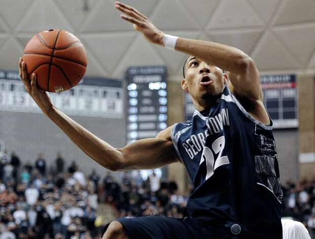 Georgetown's Otto Porter Jr. goes up for the game-winning basket during the second overtime of an NCAA college basketball game against Connecticut in Storrs, Conn., Wednesday, Feb. 27, 2013. Georgetown won 79-78. (AP Photo/Jessica Hill) Photo: Jessica Hill, Associated Press / FR125654 AP