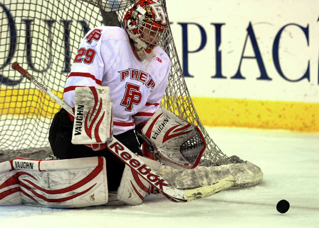 Fairfield Prep goalie Matt Beck deflects a Notre Dame of West Haven puck, during SCC boys hockey playoff championship action at High Point Solutions Arena at Quinnipiac University in Hamden, Conn. on Wednesday February 27, 2013. Photo: Christian Abraham / Connecticut Post