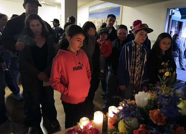 Residents gather to view a memorial arranged at a community vigil in Santa Cruz, Calif. on Wednesday, Feb. 27, 2013, for the two police detectives that were killed in the line of duty on Tuesday. Photo: Paul Chinn, The Chronicle