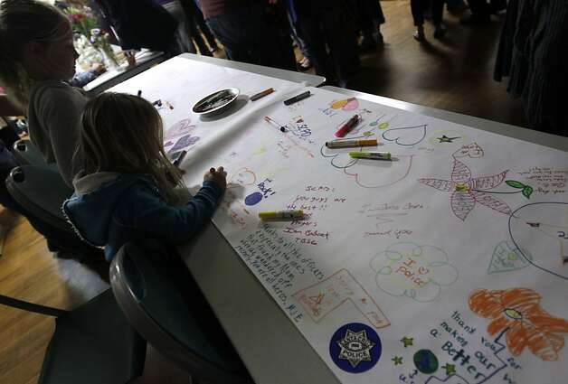 Children leave messages of condolence at a community vigil in Santa Cruz, Calif. on Wednesday, Feb. 27, 2013, for the two police detectives that were killed in the line of duty on Tuesday. Photo: Paul Chinn, The Chronicle