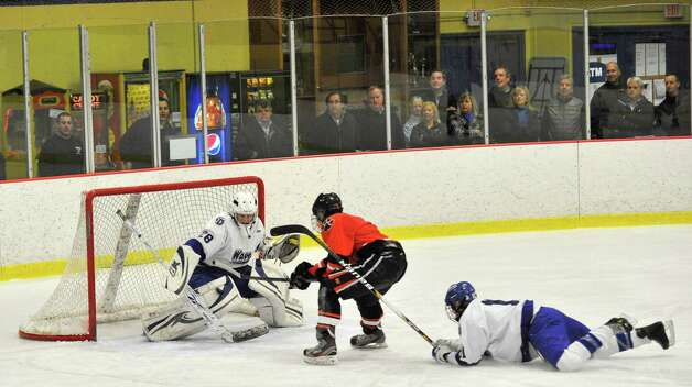 Ridgefield's Chris Morrow is denied by Darien goalie Michael Collins after Morrow got past Nicholas Tuzinkiewicz during their FCIAC semifinal game at Terry Conners Rink in Stamford on Wednesday, Feb. 27, 2013. Photo: Jason Rearick / The Advocate
