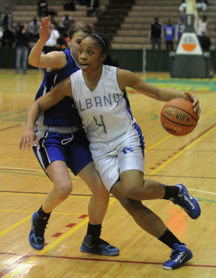 Albany's Emia Willingham-Hurst drives to the basket during their Section II Class AA girl's basketball semifinal game against Shaker on Wednesday Feb. 27, 2013 in Troy, N.Y. (Michael P. Farrell/Times Union) Photo: Michael P. Farrell