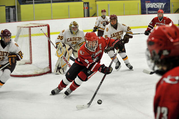 New Canaan's Henry Stanton sets up for another attack on the Darien goal during their FCIAC semifinal game at Terry Conners Rink in Stamford on Wednesday, Feb. 27, 2013. Photo: Jason Rearick / The Advocate
