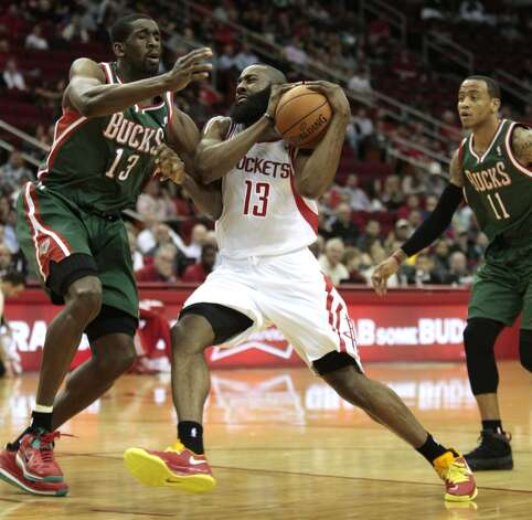 Feb. 27: Bucks 110, Rockets 107Bucks center Ekpe Udoh defends Rockets guard James Harden as Monta Ellis helps.