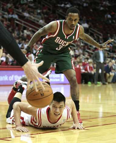 Jeremy Lin falls to the court after he looses the ball.