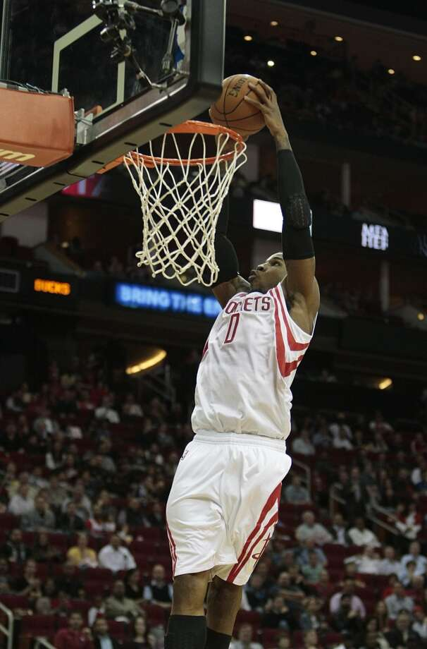 Rockets forward Thomas Robinson dunks.