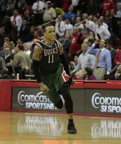 Bucks guard Monta Ellis runs off the court after hitting a game winning three.