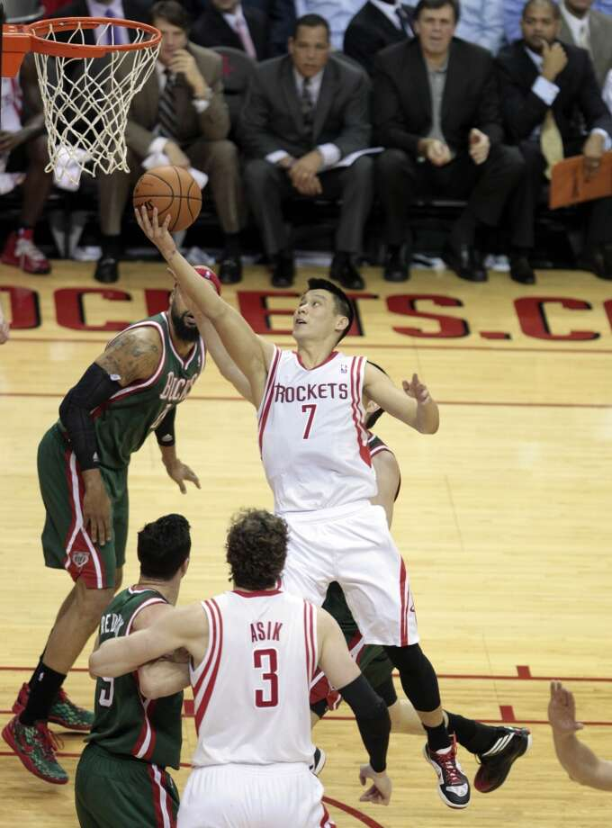 Rockets guard Jeremy Lin gets tries his luck at a layup.