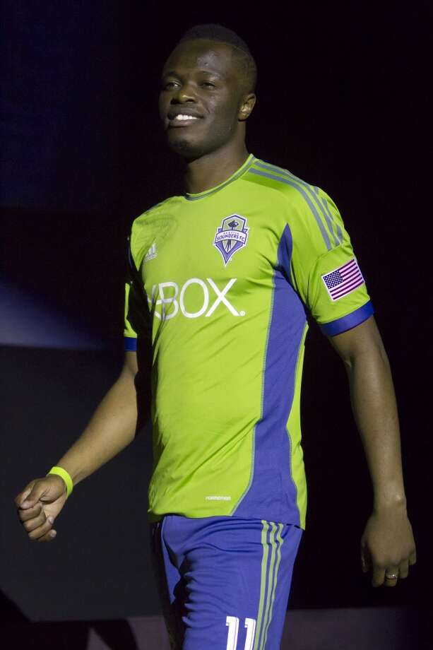 Sounders FC midfielder Steve Zakuani shows off the new 2013 season primary uniform of the Seattle Sounders FC.