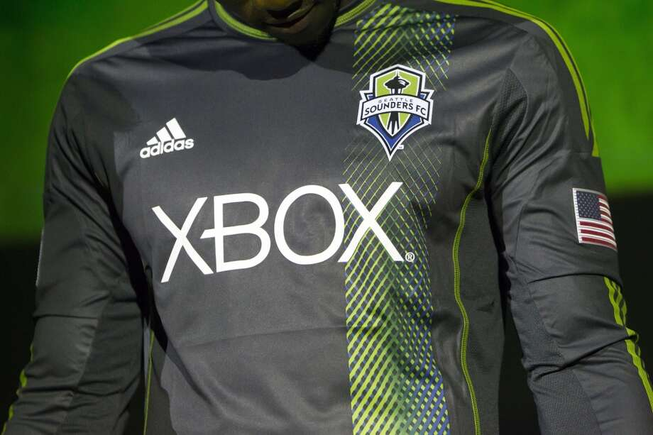 Eddie Johnson observes the details of the new secondary uniforms of the Seattle Sounders FC.