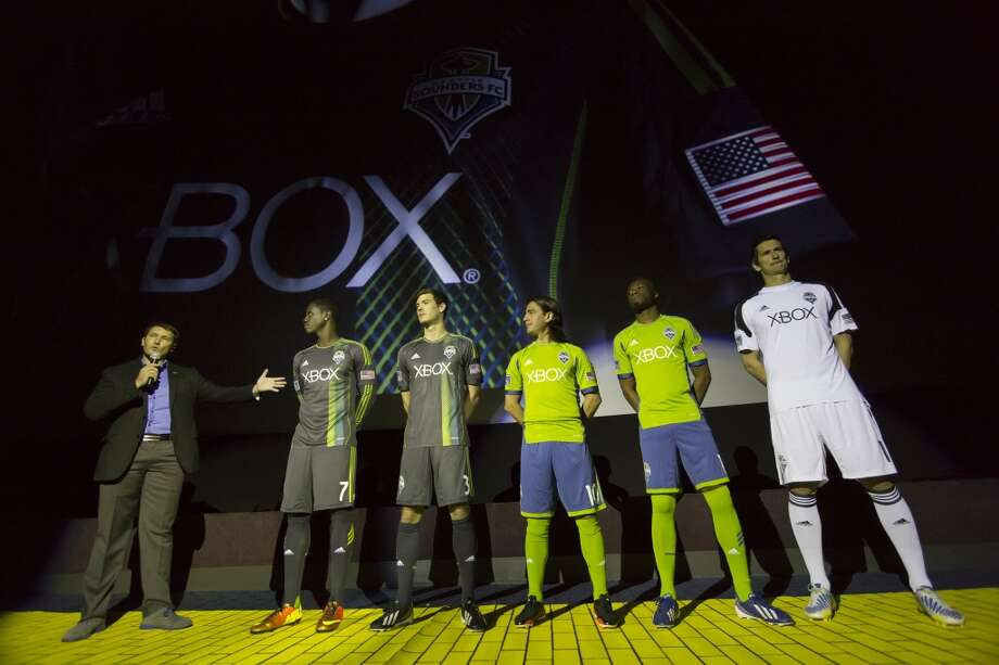 Mike Walker, global project manager at Adidas, left, addresses Sounders FC players (from left) Eddie Johnson, Brad Evans, Mauro Rosales, Steve Zakuani and Michael Gspurning at the unveiling event for the new 2013 season uniforms of the Seattle Sounders FC.