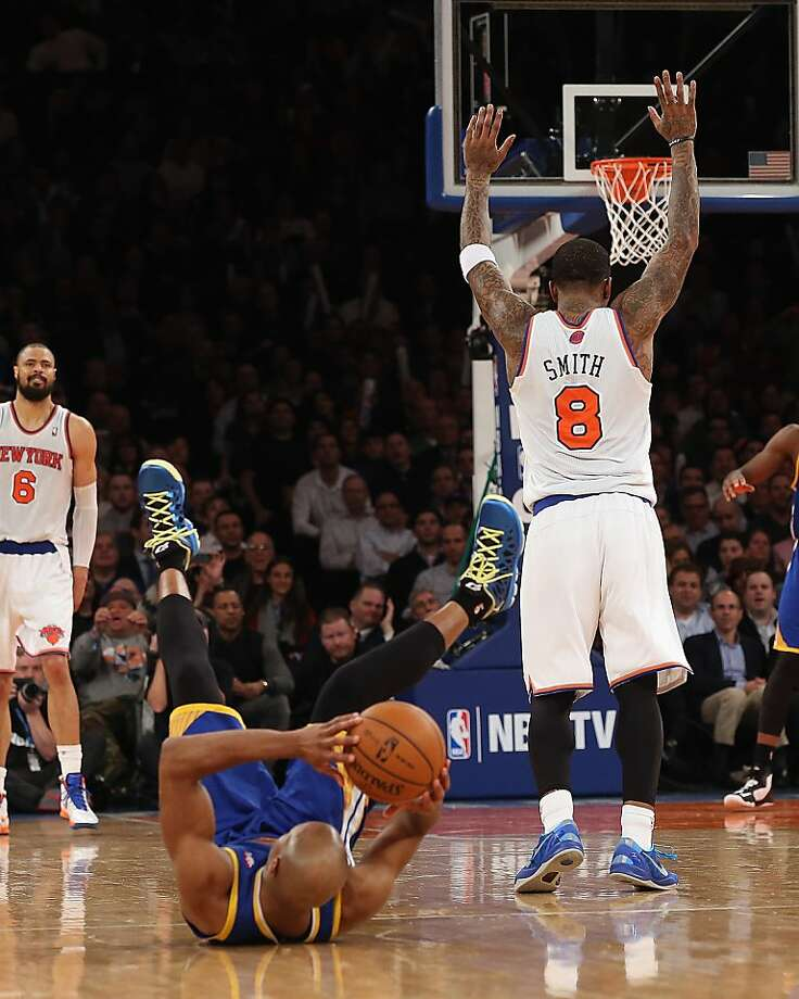 NEW YORK, NY - FEBRUARY 27: Raymond Felton #2 of the New York Knicks signals that he isn't guilty in dumping Jarrett Jack #2 of the Golden State Warriors at Madison Square Garden on February 27, 2013 in New York City. NOTE TO USER: User expressly acknowledges and agrees that, by downloading and/or using this photograph, user is consenting to the terms and conditions of the Getty Images License Agreement.  The Knicks defeated the Warriors 109-105. (Photo by Bruce Bennett/Getty Images) Photo: Bruce Bennett, Getty Images