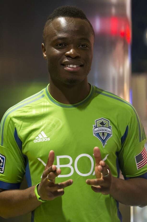 Steve Zakuani smiles for the cameras at the unveiling event for the new uniforms of the Seattle Sounders FC.
