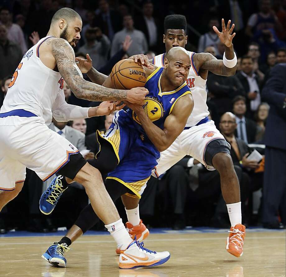 New York Knicks' Tyson Chandler, left, and Iman Shumpert, right, defend against Golden State Warriors' Jarrett Jack (2) during the second half of an NBA basketball game, Wednesday, Feb. 27, 2013, in New York. Jack was called for traveling on the play, resulting in a turnover. The Knicks won 109-105. (AP Photo/Frank Franklin II) Photo: Frank Franklin II, Associated Press