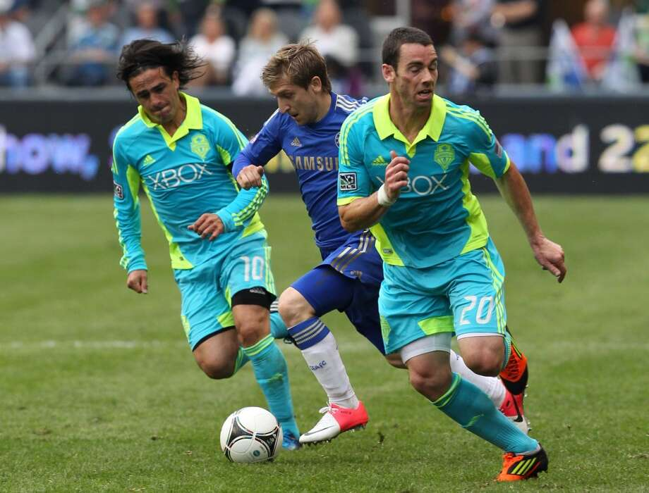 In 2011, continuing with a tradition of bright colors, the Sounders introduced these neon-blue uniforms. Note that the jerseys include collars.