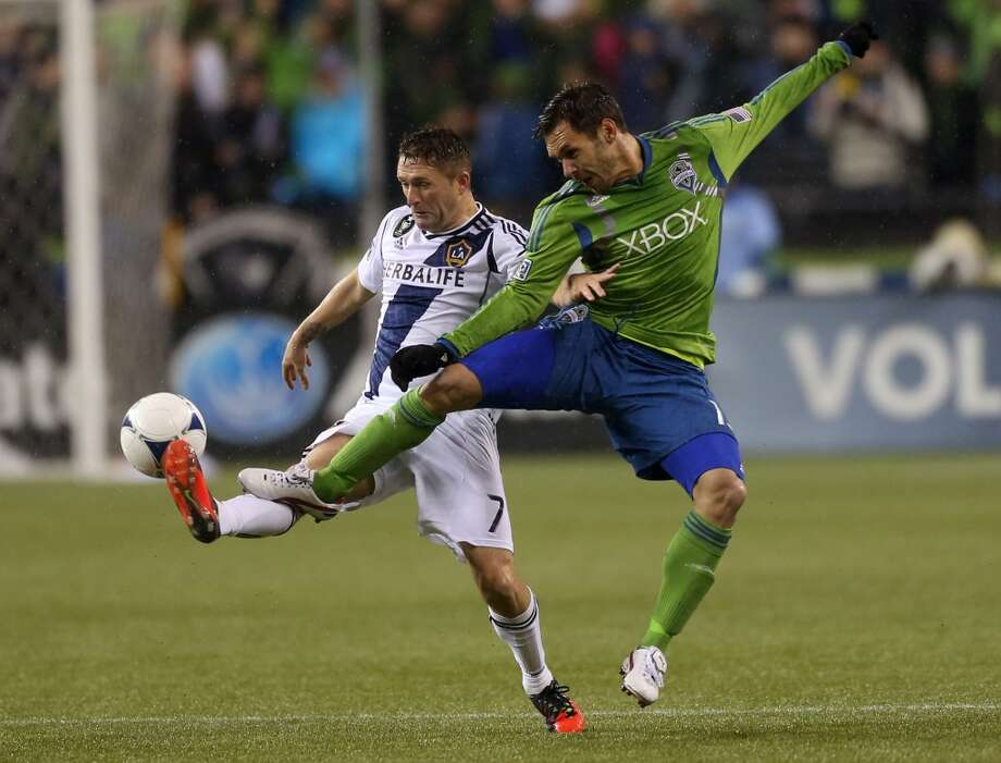 In 2012, the Sounders were still wearing the green jerseys with blue and silver under-arm stripes. But sometimes they mixed and matched them with blue shorts, as seen here.
