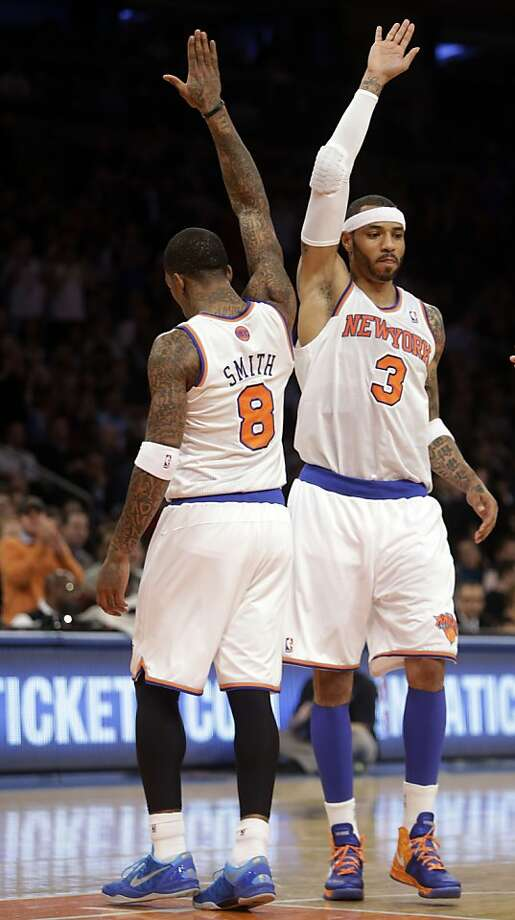 New York Knicks' Kenyon Martin (3) high-fives teammate J.R. Smith (8) as he checks into the game during the first half of an NBA basketball game on Wednesday, Feb. 27, 2013, in New York. (AP Photo/Frank Franklin II) Photo: Frank Franklin II, Associated Press