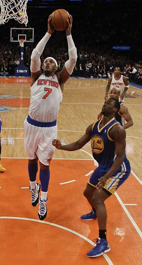 New York Knicks' Carmelo Anthony (7) drives past Golden State Warriors' Harrison Barnes (40) during the first half of an NBA basketball game on Wednesday, Feb. 27, 2013, in New York. The Knicks won the game 109-105. (AP Photo/Frank Franklin II) Photo: Frank Franklin II, Associated Press