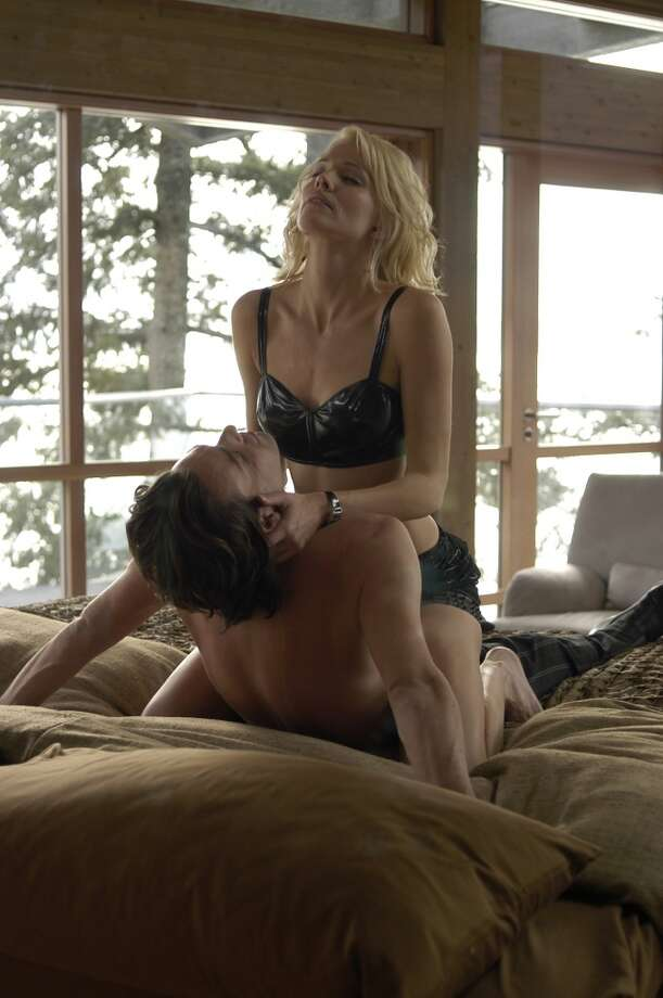 Dr. Baltar (James Callis) and Number Six (Tricia Helfer) from the 2003 ''Battlestar Galactica'' mini-series.