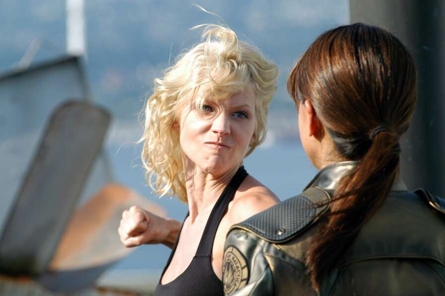 Number Six (Tricia Helfer) punches Lt. Boomer (Grace Park) in the 2004 episode Litmus.