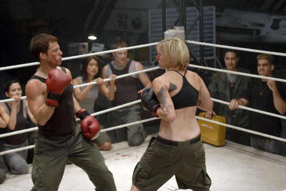 Apollo (Jamie Bamber), left, and Starbuck (Katee Sackhoff) box it out in the episode ''Unfinished Business.''