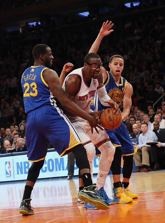 NEW YORK, NY - FEBRUARY 27: Amar'e Stoudemire #1 of the New York Knicks carries the ball past Draymond Green #23 and Stephen Curry #30 of the Golden State Warriors at Madison Square Garden on February 27, 2013 in New York City. NOTE TO USER: User expressly acknowledges and agrees that, by downloading and/or using this photograph, user is consenting to the terms and conditions of the Getty Images License Agreement.  The Knicks defeated the Warriors 109-105. (Photo by Bruce Bennett/Getty Images) Photo: Bruce Bennett, Getty Images