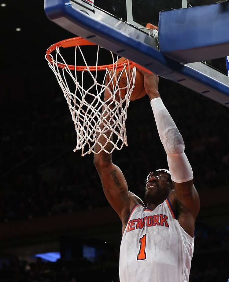NEW YORK, NY - FEBRUARY 27: Amar'e Stoudemire #1 of the New York Knicks scores two in the third quarter against the Golden State Warriors at Madison Square Garden on February 27, 2013 in New York City. NOTE TO USER: User expressly acknowledges and agrees that, by downloading and/or using this photograph, user is consenting to the terms and conditions of the Getty Images License Agreement.  The Knicks defeated the Warriors 109-105. (Photo by Bruce Bennett/Getty Images) Photo: Bruce Bennett, Getty Images