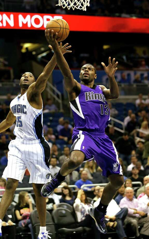 Sacramento Kings' Tyreke Evans (13) shoots in front of Orlando Magic's E'Twaun Moore (55) during the first half of an NBA basketball game, Wednesday, Feb. 27, 2013, in Orlando, Fla. (AP Photo/John Raoux) Photo: John Raoux