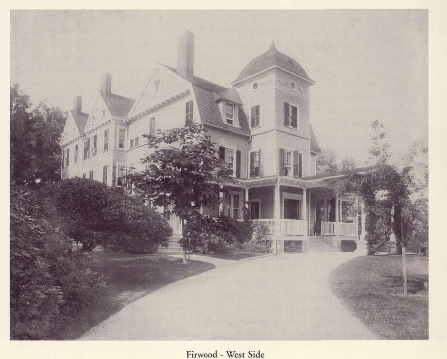 This historic photo shows the mansion from its west side, as though the photographer was standing right about in the spot where the Demolition sign now stands.