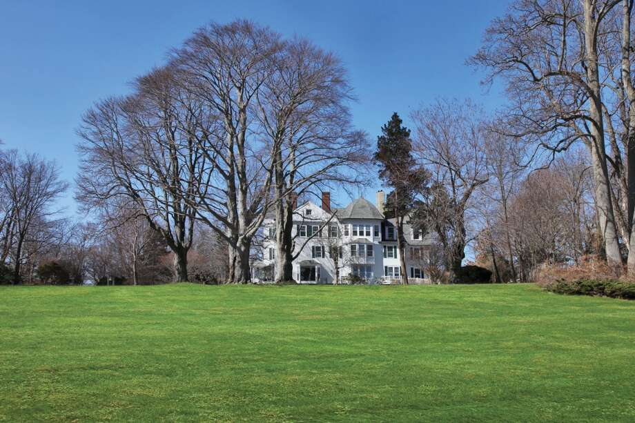 This file photo shows Firwood when it was originally put on the market. Original caption: Firwood, a Darien waterfront estate has 325 feet on L.I. Sound, a swimming pool, gardens and 4.84 acres in a one-acre zone. The estate remained in one family for 129 years. Inside Firwood, first built in 1860, and rebuilt and expanded 30 years later, are 14 bedrooms, nine baths and 13 elaborate antique fireplaces. Three living levels, with both walk-up attic and basement, the house features turrets, multiple chimneys and spectacular views.