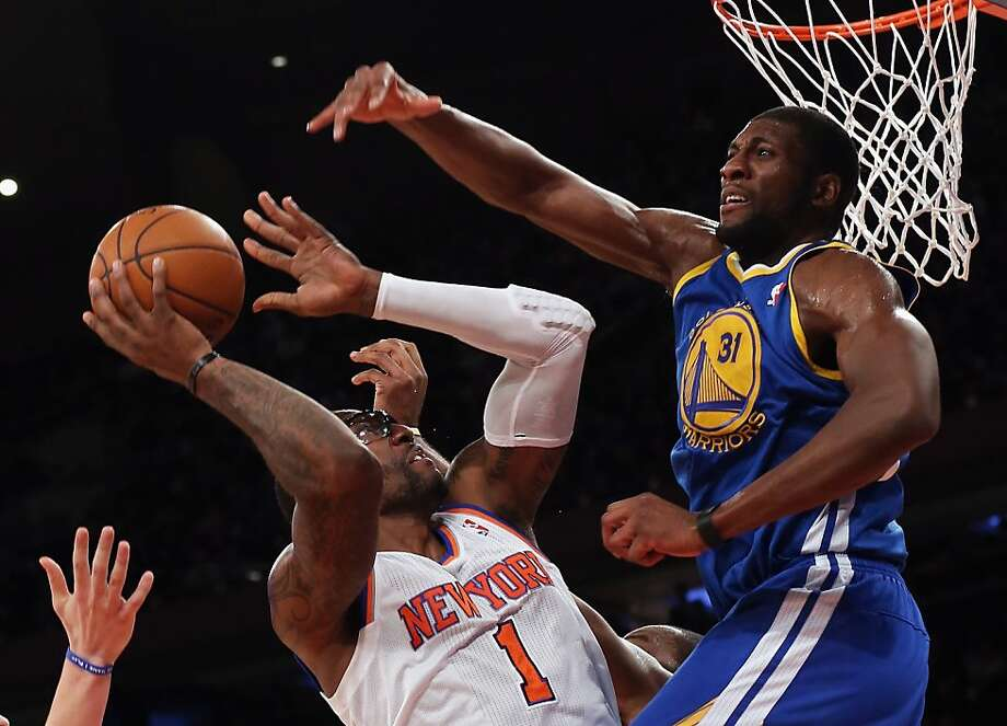 NEW YORK, NY - FEBRUARY 27:  Festus Ezeli #31 of the Golden State Warriors blocks Amar'e Stoudemire #1 of the New York Knicks at Madison Square Garden on February 27, 2013 in New York City. NOTE TO USER: User expressly acknowledges and agrees that, by downloading and/or using this photograph, user is consenting to the terms and conditions of the Getty Images License Agreement. 1nc0m1ngF1eld (Photo by Bruce Bennett/Getty Images) Photo: Bruce Bennett, Getty Images
