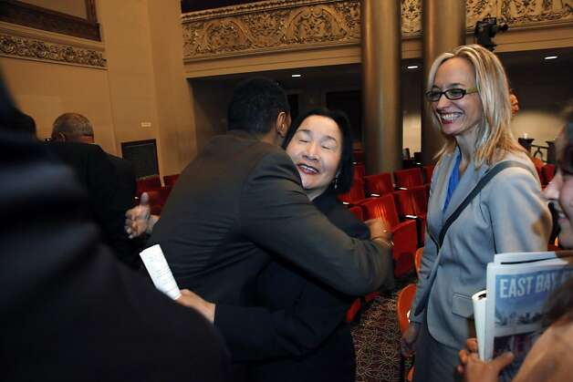 Oakland Mayor Jean Quan, center, gets a hug from Ken Maxey, left, after she gave the state of the city speech at City Hall in Oakland, Calif., on Wednesday, February 27, 2013. Photo: Carlos Avila Gonzalez, The Chronicle