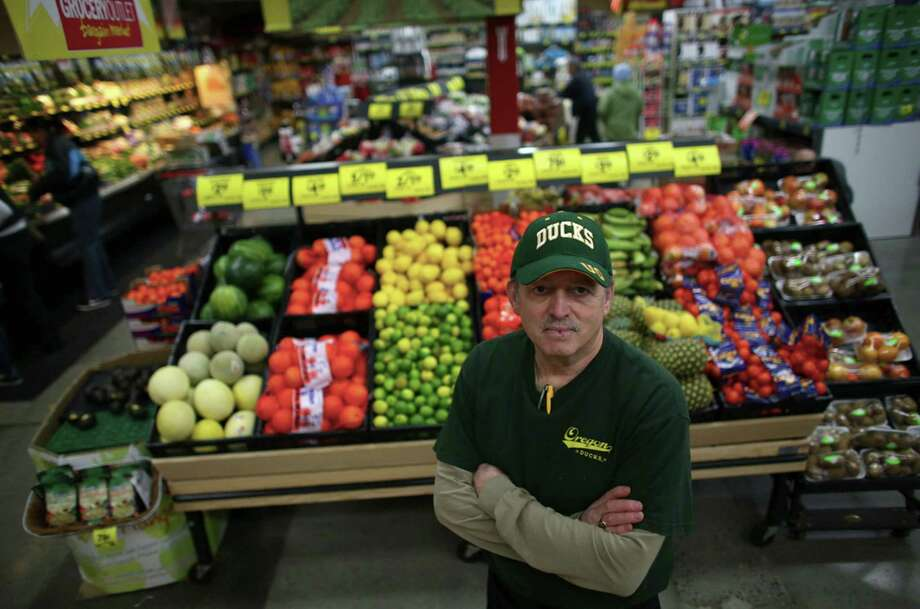 Store owner Mike Duke is shown at the Lake City Grocery Outlet. He has worked to prevent theft at the store but partly blames the plastic bag ban as customers bring their own bags into the store and often fill them with products they do not pay for. Photo: JOSHUA TRUJILLO / SEATTLEPI.COM