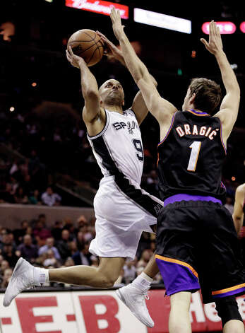San Antonio Spurs' Tony Parker (9), of France, shoots over Phoenix Suns' Goran Dragic (1), of Slovenia, during the first half of an NBA basketball game, Wednesday, Feb. 27, 2013, in San Antonio. Photo: Eric Gay, Associated Press / AP