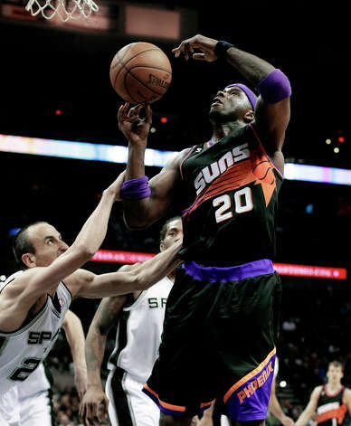 Phoenix Suns' Jermaine O'Neal (20) is fouled by San Antonio Spurs' Manu Ginobili, left, of Argentina, during the second half of an NBA basketball game, Wednesday, Feb. 27, 2013, in San Antonio. The Suns won 105-101 in overtime. Photo: Eric Gay, Associated Press / AP